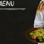 Chef With Healthy Salad Food On Chalk Blackboard Menu Background